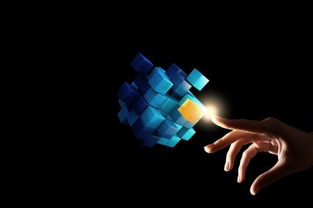Foto de Businesswoman hand touch cube as symbol of problem solving - Imagen libre de derechos