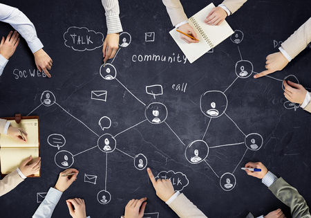 Photo pour Top view of people hands drawing networking strategy - image libre de droit