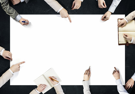 Photo pour Top view of people hands drawing business teamwork strategy - image libre de droit