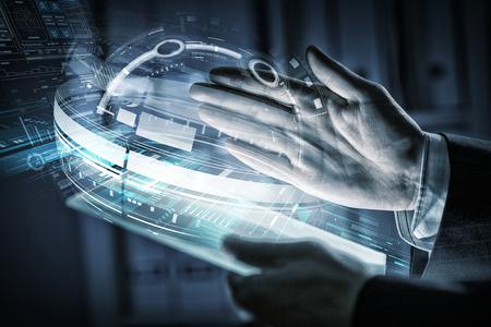 Photo pour Close up of human hands using virtual panel - image libre de droit
