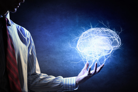 Foto de Businessman holding digital image of brain in palm - Imagen libre de derechos