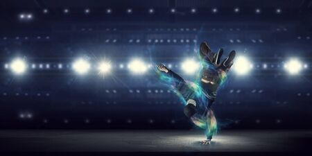 Photo for B-boy performing some moves . Mixed media - Royalty Free Image