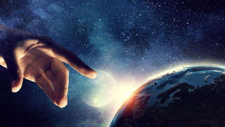 Photo for Touching planet with finger - Royalty Free Image