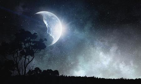 Foto de Moon with face of kid boy in night sky. Mixed media - Imagen libre de derechos
