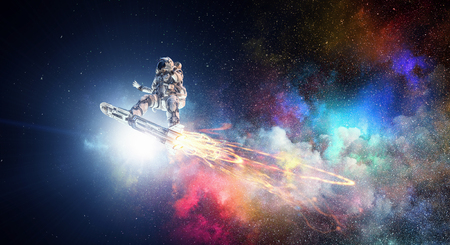 Photo pour Astronaut flying on futuristic rocket skateboard in outer space. Mixed media - image libre de droit