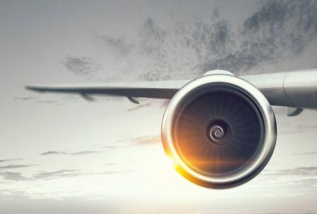 Photo pour Close of airplane in sky. Mixed media - image libre de droit