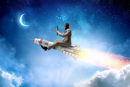Photo pour Aviator riding rocket. Mixed media - image libre de droit