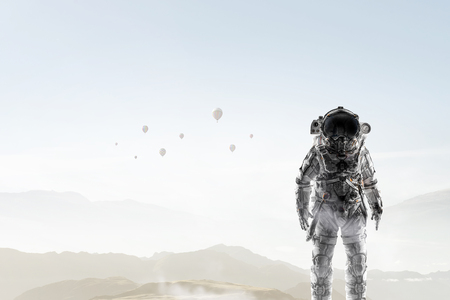 Photo for Space explorer in astronaut suit. Mixed media - Royalty Free Image