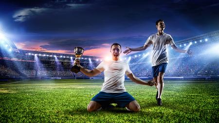 Photo pour Soccer player at stadium. Mixed media - image libre de droit