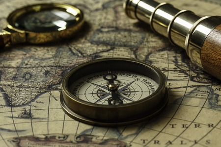 Photo for Retro compass with old map and spyglass - Royalty Free Image