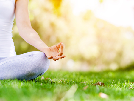 Photo for Woman meditating in the park - Royalty Free Image