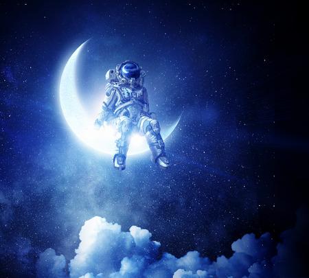 Foto de Astronaut sit on crescent moon. Mixed media - Imagen libre de derechos