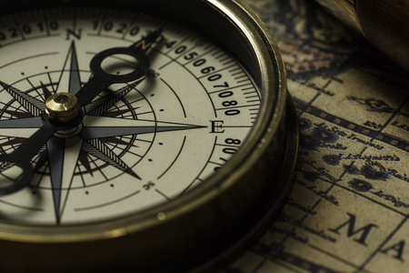 Foto de Concept of travel and discovery with old map and compass on it - Imagen libre de derechos