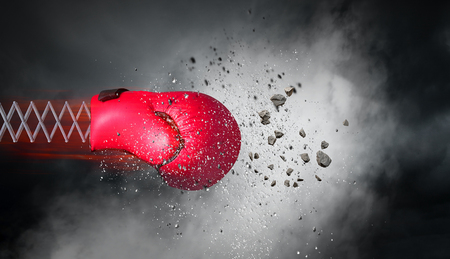 Foto de Boxing glove on spring on dark sky background. Mixed media - Imagen libre de derechos