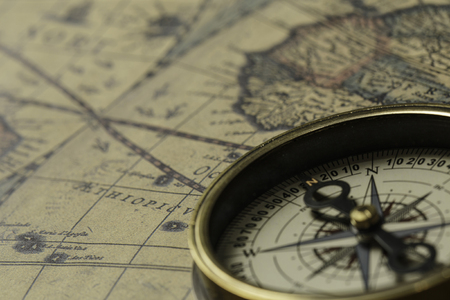 Photo for Concept of travel and discovery with old map and compass on it - Royalty Free Image