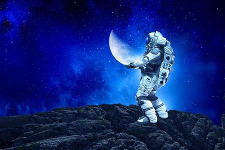 Foto de Astronaut holding moon planet in hands. - Imagen libre de derechos
