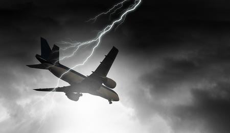 Foto de Lightning in sky striking airplane. Mixed media - Imagen libre de derechos