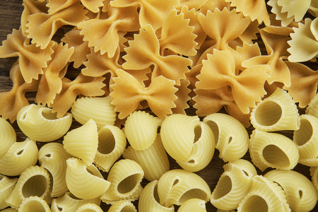 Photo for Lots of various dry noodles on table - Royalty Free Image