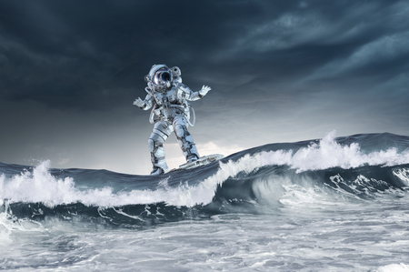 Photo pour Spaceman on flying board surfing the sea. Mixed media - image libre de droit