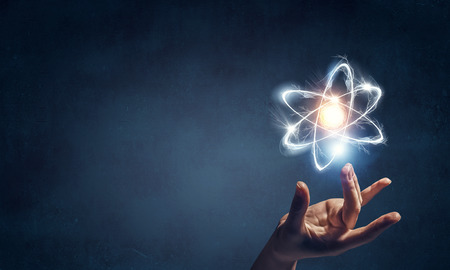 Photo for Human hand and atom molecule as science concept. 3d rendering - Royalty Free Image