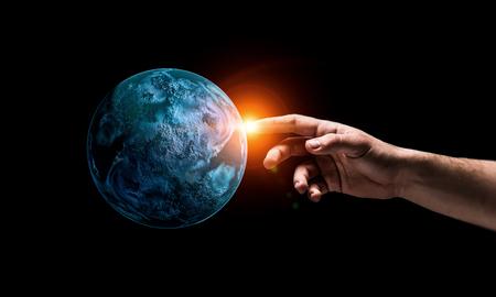 Foto de Close of hand touching with finger planet - Imagen libre de derechos