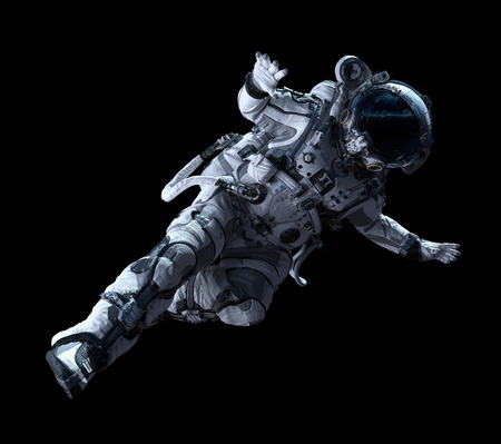 Foto de Spaceman in white suit on black background. Mixed media - Imagen libre de derechos