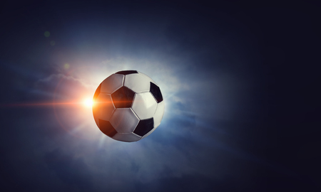Photo for Soccer ball flying through air in lights of stadium. Mixed media - Royalty Free Image