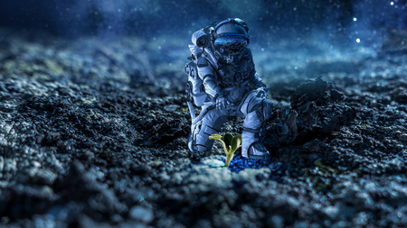 Photo for Astronaut in space suit reaching hand to touch sprout. Mixed media - Royalty Free Image