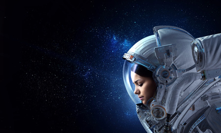 Photo pour Attractive woman in spacesuit - image libre de droit