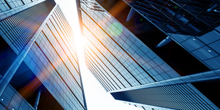 Foto per Bottom angle view of glass blue building - Immagine Royalty Free