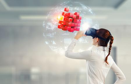Foto de Experiencing virtual technology world. Mixed media - Imagen libre de derechos