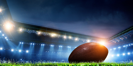 Photo pour Empty night football arena in lights - image libre de droit