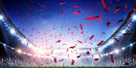 Foto de Football stadium background with flying confetti - Imagen libre de derechos