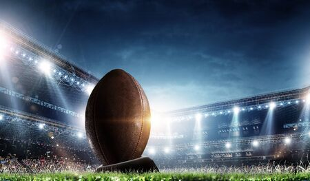 Photo pour Night football arena in lights with a ball close up - image libre de droit