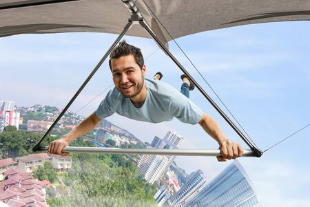 Foto de Young man flying on hang glider. Mixed media - Imagen libre de derechos