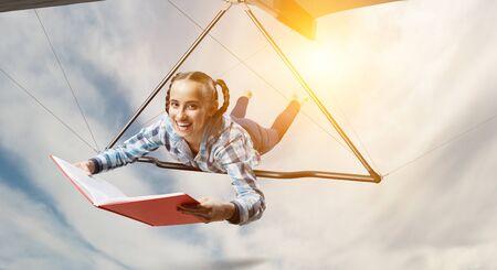 Foto de Young woman flying on hang glider. Mixed media - Imagen libre de derechos