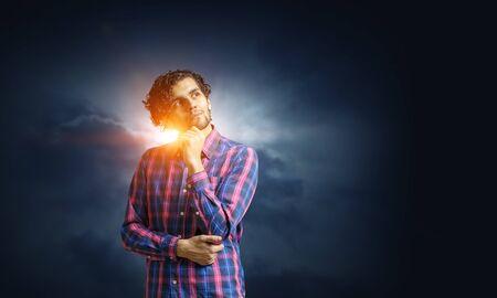 Photo for Man thinking and seeking new idea concept. Mixed media - Royalty Free Image