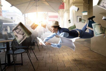 Foto de Smiling Joyful levitating young man - Imagen libre de derechos