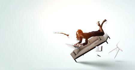Foto de Joyful beautiful young levitating businesswoman - Imagen libre de derechos