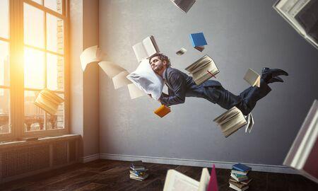 Foto de Joyful happe businessman levitating horizontally - Imagen libre de derechos