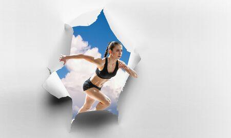 Foto de Woman on cloud in the Hole of wallpaper. Mixed media - Imagen libre de derechos