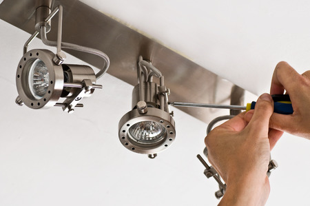 Foto de light installation - electrician hand closeup - Imagen libre de derechos