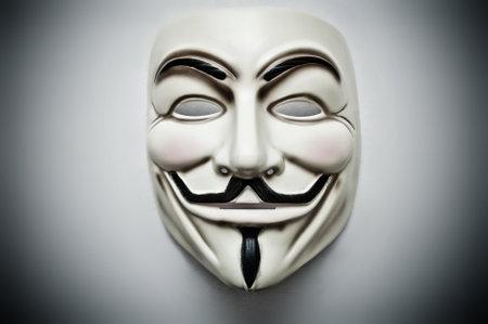 Foto de Vendetta mask symbol for the online hacktivist group Anonymous - Imagen libre de derechos