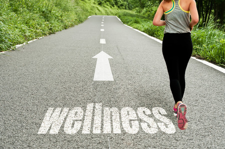 Foto de concept illustrating with running girl on the road the wellness and good health - Imagen libre de derechos