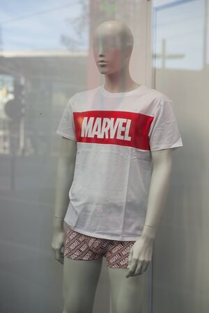 Foto de Mulhouse - France - 31 December 2019 - Closeup of Marvel logo on white teeshirt in a fashion store showroom - Imagen libre de derechos