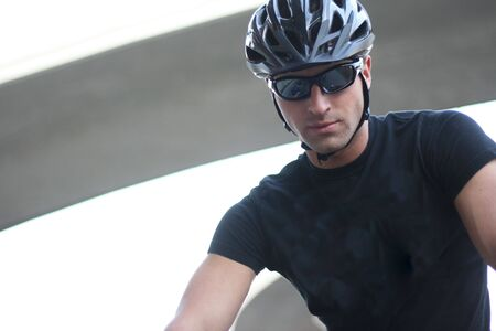 Photo Of A Cyclist Man With Sunglasses And Helmet