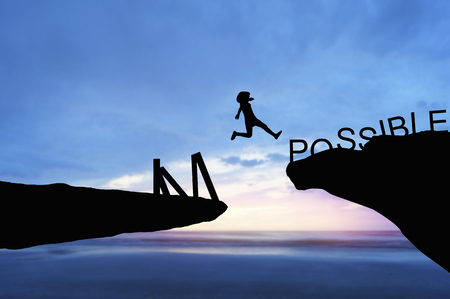 Photo pour silhouette people jumping over the rock frome word impossible to possible - image libre de droit