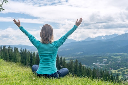 Photo for Blonde Woman Doing Yoga at the Mountains - Royalty Free Image