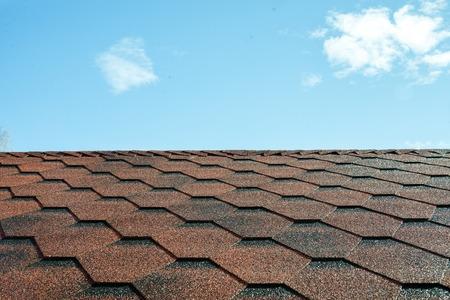 Photo pour Tile roofs, patterns of the blue sky - image libre de droit