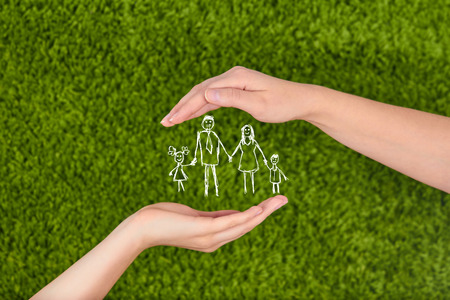 Foto de Family insurance, protecting family, family concepts. - Imagen libre de derechos
